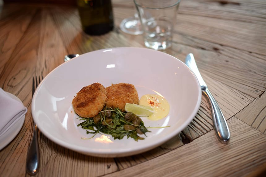 Maryland Crab Cakes with Saffron Aioli, Rocket and Caper Salad at The Bastion Bar & Restaurant